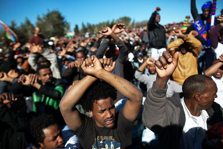 More than 10,000 African asylum seekers protest Israel's immigration policy in front of the parliament. Photo: Menahem Kahana, AFP/Getty Images