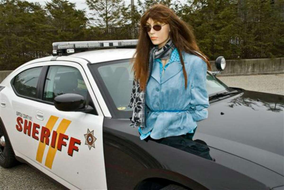 """This photo proivided by the Suffolk County, N.Y., Sheriff's Dept., Wednesday Feb. 3, 2010, shows a mannequin on the hood of one of their cruisers. A New Yorker faces a $135 traffic fine for using a mannequin as her plus-one in the high-occupancy lane of the Long Island Expressway. An alert sheriff's deputy on Long Island became suspicious when he saw the """"passenger"""" wearing sunglasses and using the visor. The only problem: The sky was overcast. (AP Photo/Suffolk County Sheriff)"""