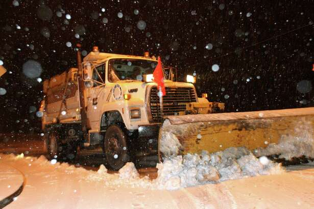 A snowplow from the City of Brier clears the road as snow falls on December 17, 2008.(Karen Ducey/Seattle Post-Intelligencer)