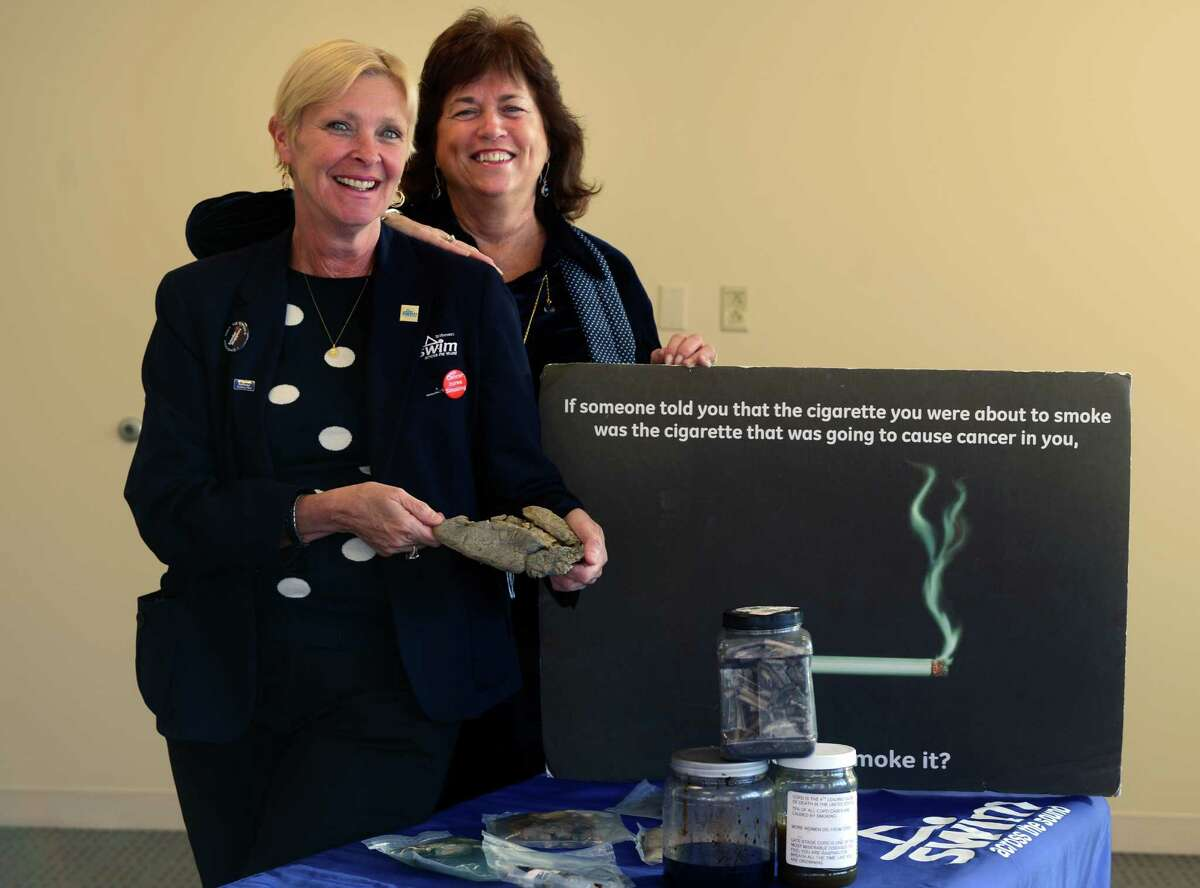 Susan Richards and Maryellen Bolcer, of Smoke Stoppers, pose with some of their teaching tools from the smoking cessation program they run for St. Vincent's Medical Center.