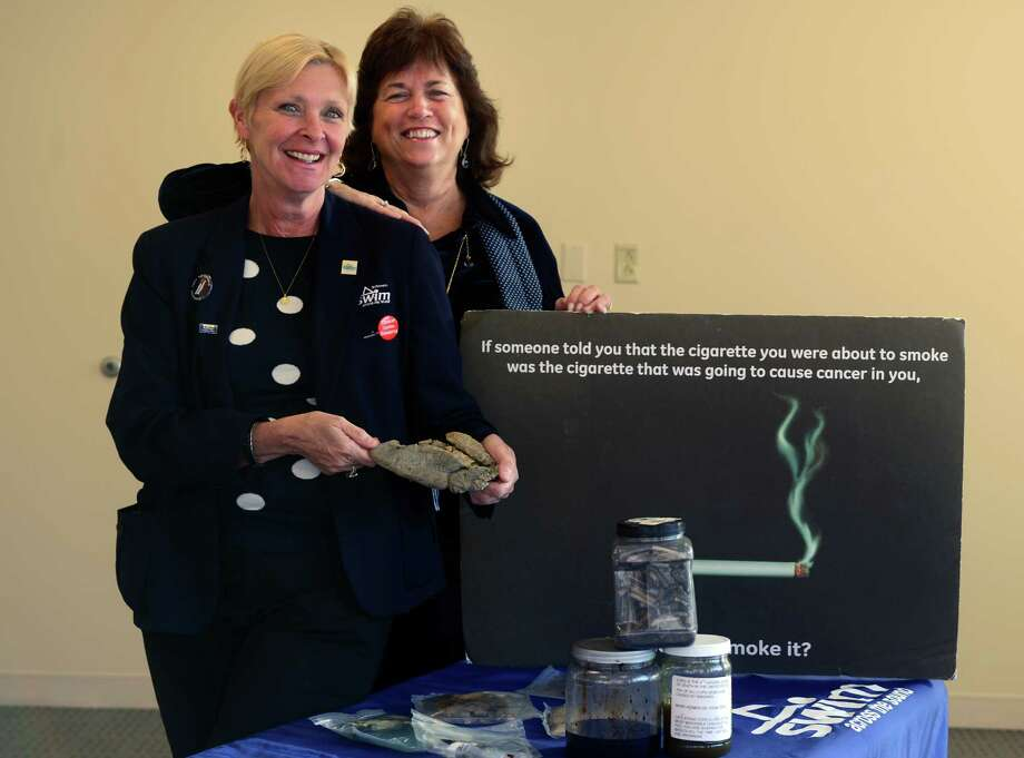 Susan Richards and Maryellen Bolcer, of Smoke Stoppers, pose with some of their teaching tools from the smoking cessation program they run for St. Vincent's Medical Center. Photo: Autumn Driscoll / Connecticut Post