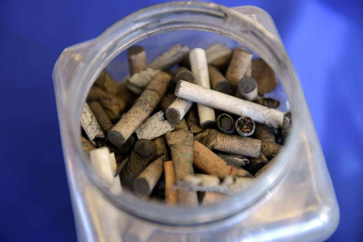 A container of cigarette butts is among the teaching tools Smoke Stoppers use in their smoking cessation program.