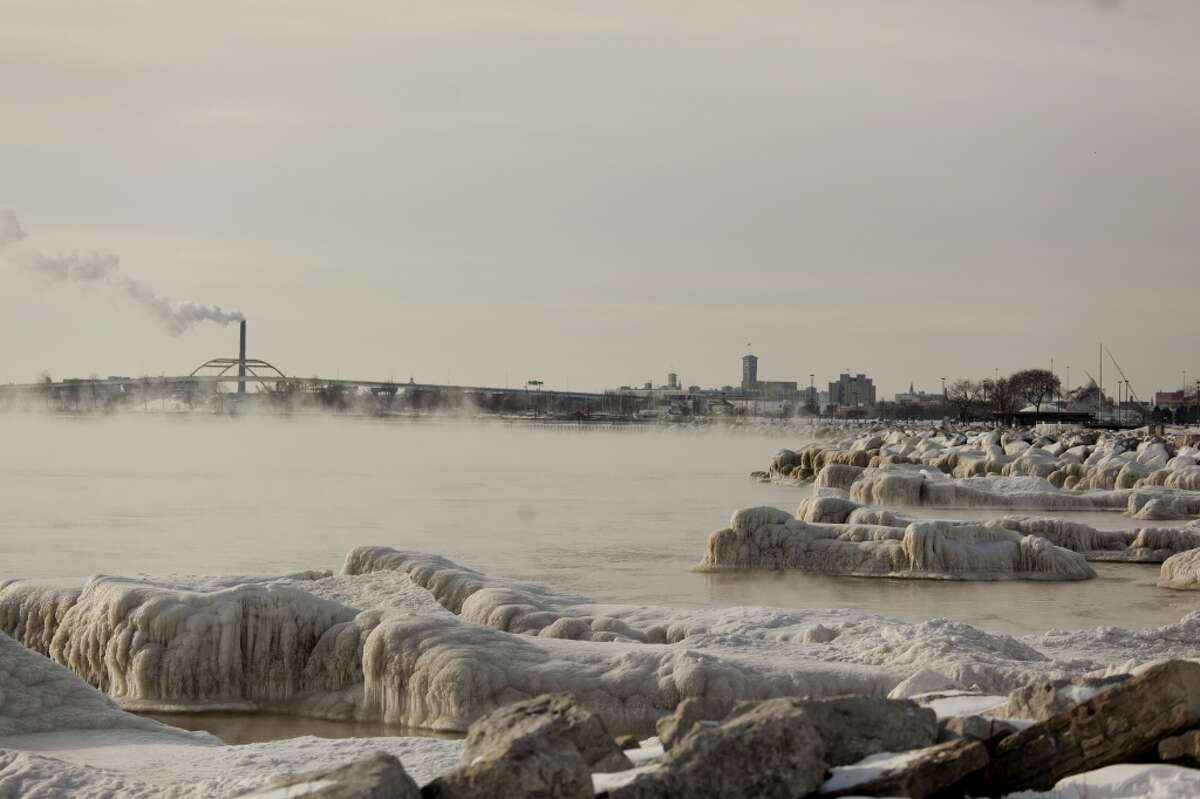Steam rises off the water along the icy shore of Lake Michigan as temperatures remain in the negative digits on Jan. 7, 2014 in Milwaukee, Wis. A 'polar vortex' of frigid air centered on the North Pole dropped temperatures to the negative double digits at its worst. (Photo by Darren Hauck/Getty Images)