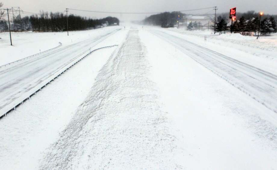 A empty stretch of the New York State thruway in Hamburg, N.Y., after it was closed down due to high winds, Tuesday, Jan. 7, 2014. (AP Photo/The Buffalo News, Harry Scull Jr.) Photo: HARRY SCULL JR, Associated Press