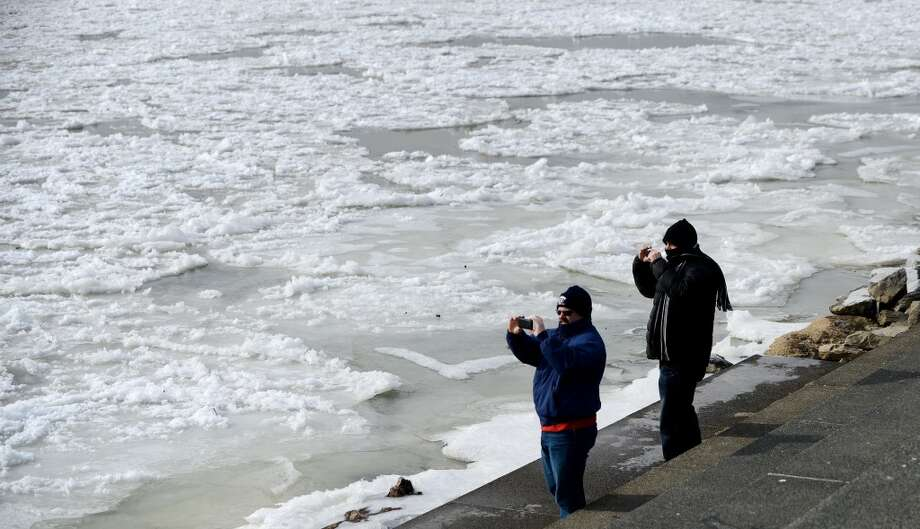 People take pictures of the frozen waters of the Washington Channel, on Jan. 8, 2014, in Washington. A polar vortex that has swept the east coast brought dangerously cold temperatures. (Olivier Douliery/Abaca Press/MCT) Photo: Olivier Douliery, McClatchy-Tribune News Service