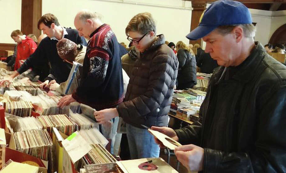 Browsers check out  LPS at last year's  Mid-Winter Book Sale at the Pequot Library. This year, the sale will be held on Saturday, Jan. 18 and Sunday, Jan. 19. Photo: Contributed Photo / Fairfield Citizen