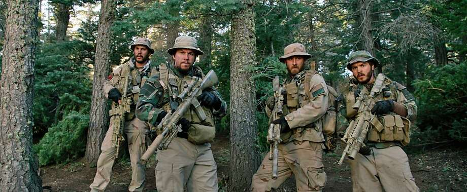 "Taylor Kitsch (left) and Mark Wahlberg in ""Lone Survivor."" Photo: Universal Pictures"