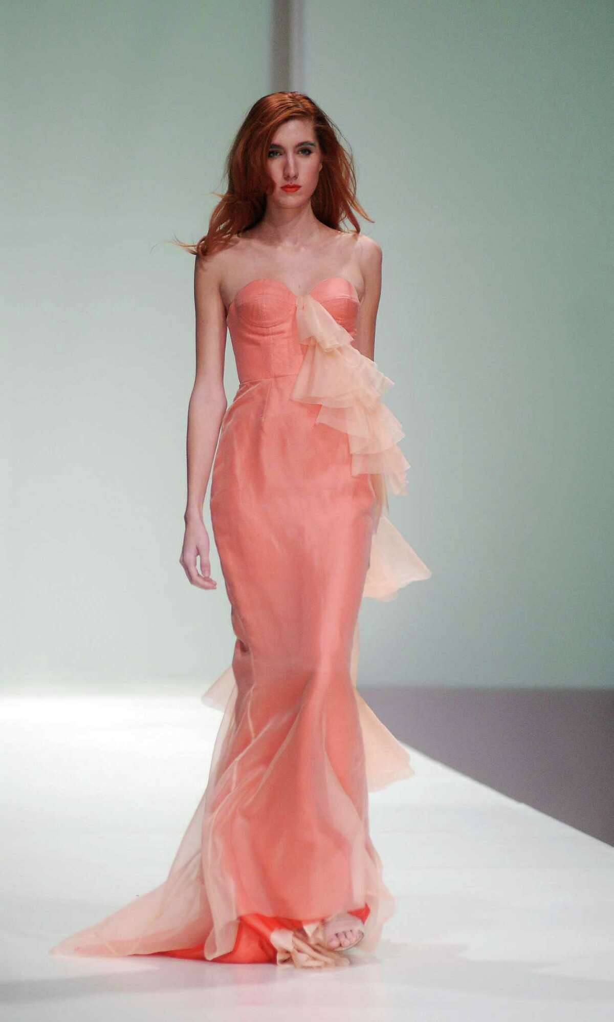 HOUSTON MADE:Local designer David Peck showed a soft-cayenne color gown at his Fashion Houston runway show; davidpeckusa.com.