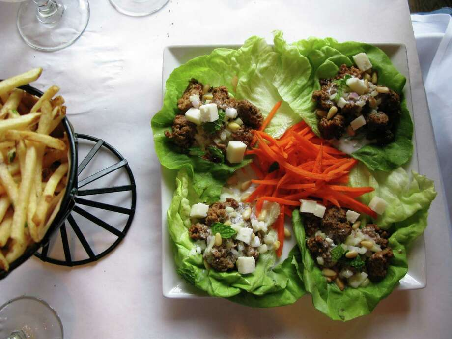 Bistro 412 in Park City, Utah, offers up these lamb lettuce wraps. Whatever reason a tourist stops in Park City, more than 100 restaurants and watering holes keep them well nourished with upscale food. Photo: Bill Daley, MBR / MCT
