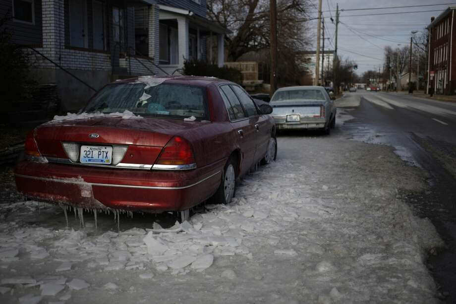 A sedan sits encased in ice after firefighters battled a nearby fire in bitter cold below-zero temperatures on Jan. 7, 2014 in Louisville, Kentucky. Temperatures in the single digits coupled with below-zero wind chills have prompted the closure of local governments, schools, and businesses throughout the South. (Photo by Luke Sharrett/Getty Images) Photo: Luke Sharrett, Getty Images