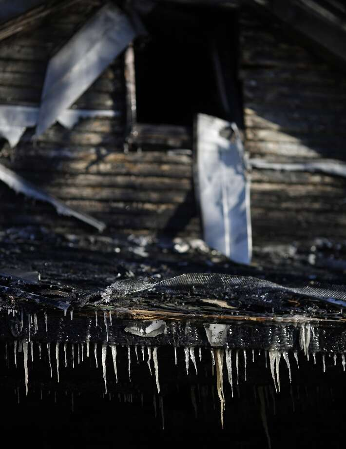 Icicles formed by water from fire department hoses hang from the charred remnants of 58-year-old Gerry Jennette's home in bitter cold below-zero temperatures on Jan. 7, 2014 in Louisville, Kentucky. Firefighters blamed the blaze, which occurred last night, on a faulty space heater. Temperatures in the single digits coupled with below-zero wind chills have prompted the closure of local governments, schools, and businesses throughout the South. (Photo by Luke Sharrett/Getty Images) Photo: Luke Sharrett, Getty Images