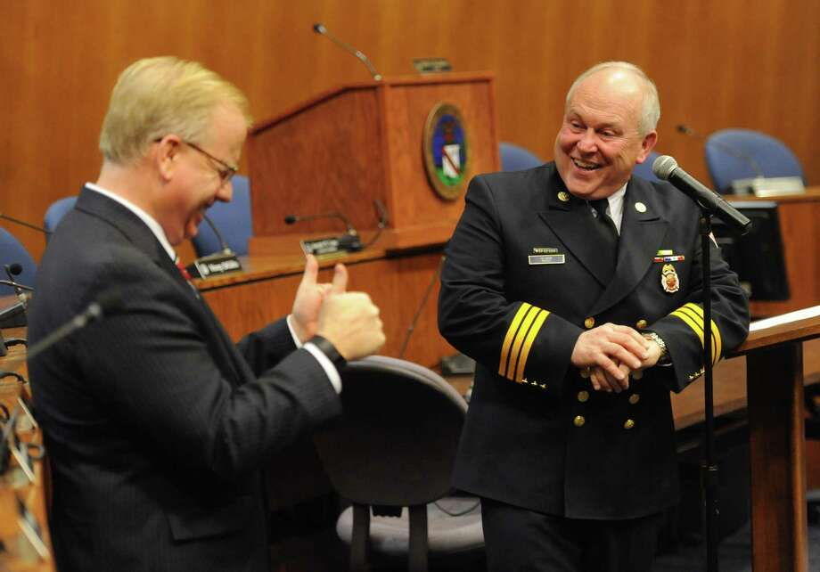 Jim Russell, right. shares a laugh with Danbury Mayor Mark Boughton after being sworn in as the new city fire marshal in the Council Chambers at City Hall in Danbury, Conn. on Wednesday, Jan. 8, 2014.  Russell, a member of the Danbury Fire Department since 2001 and a deputy fire marshal since 2009, succeeds Fire Marshal Jim Johnson, who retired earlier this year.  His appointment was unanimously approved by the City Council Tuesday evening. Photo: Tyler Sizemore / The News-Times