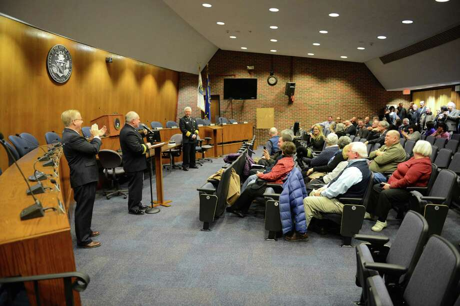 Jim Russell is sworn in as the new city fire marshal in the Council Chambers at City Hall in Danbury, Conn. on Wednesday, Jan. 8, 2014.  Russell, a member of the Danbury Fire Department since 2001 and a deputy fire marshal since 2009, succeeds Fire Marshal Jim Johnson, who retired earlier this year.  His appointment was unanimously approved by the City Council Tuesday evening. Photo: Tyler Sizemore / The News-Times