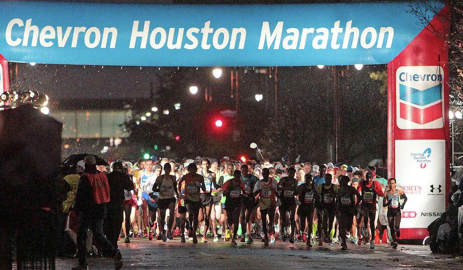 Runners leave the starting line during the Chevron Houston Marathon. Photo: James Nielsen , Chronicle / © Houston Chronicle 2013