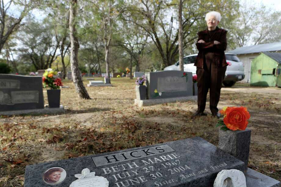 Sara Hicks stands at the grave of her daughter Beth Hicks, who was bludgeoned to death in 2004. Photo: Helen L. Montoya, San Antonio Express-News / ©2013 San Antonio Express-News