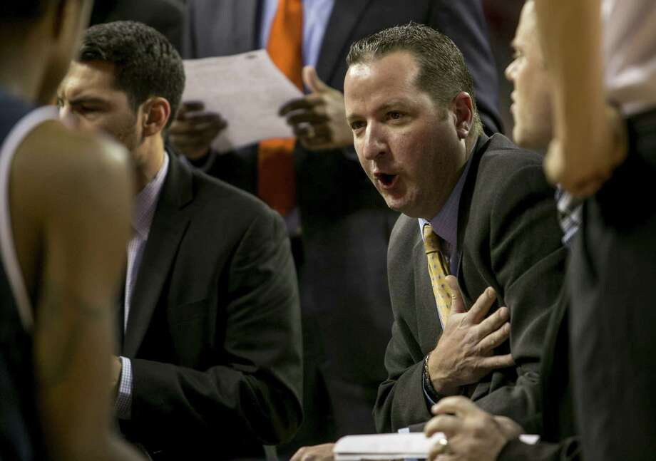 UTSA head coach Brooks Thompson instructs his team during a timeout during the second half of an NCAA college basketball game against Arkansas, Saturday, Jan. 4, 2014, in Fayetteville, Ark. Arkansas defeated UTSA 104-71. (AP Photo/Gareth Patterson) Photo: Gareth Patterson, Associated Press / FR170364 AP
