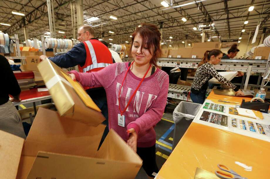 "Amazon.com employee Monica Chavez packs up a box after she wraps the gift at an Amazon.com Fulfillment Center on ""Cyber Monday"" the busiest online shopping day of the holiday season Monday, Dec. 2, 2013, in Phoenix. (AP Photo/Ross D. Franklin) ORG XMIT: AZRF120 Photo: Ross D. Franklin / AP"