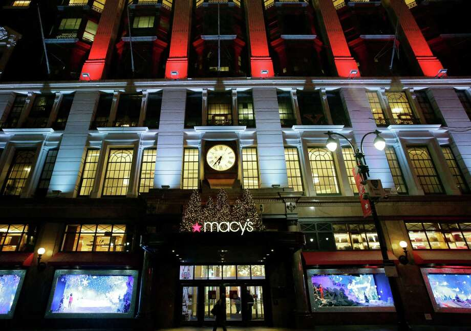 FILE - In this Tuesday, Dec. 17, 2013, file photo, Macy's department store in Herald Square is illuminated with holiday lighting, in New York.   Macy's said Wednesday, Jan. 8, 2014, it is laying off 2,500 workers as it restructures business. (AP Photo/Mark Lennihan, File) ORG XMIT: NYBZ130 Photo: Mark Lennihan / AP