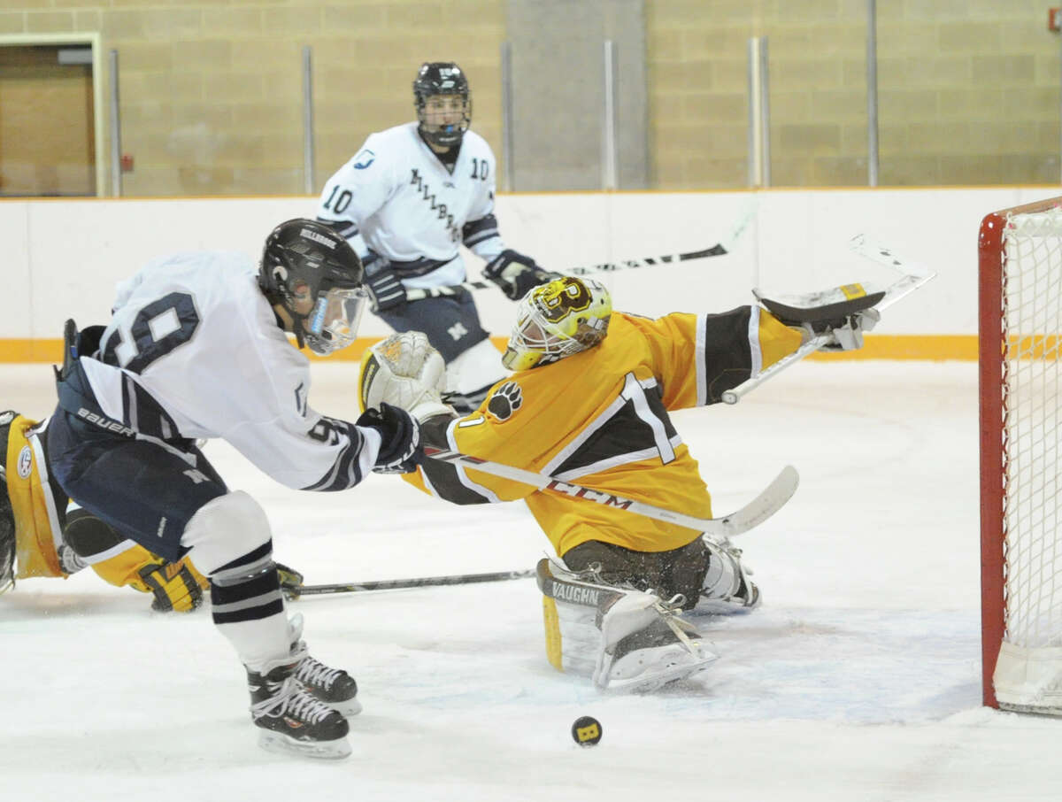 At left, Millbrook's Jacob Moreau (#9) misses on a rebound attempt as Brunswick goalie Alex Connal (#1) attempts to recover after making an initial save on a Millbrook shot during the boys high school ice hockey game between Brunswick School and Millbrook School at Brunswick in Greenwich, Wednesday afternoon, Jan. 8, 2014. No goal was scored on the play. In the background is Millbrook's Jack Loessberg (#10).