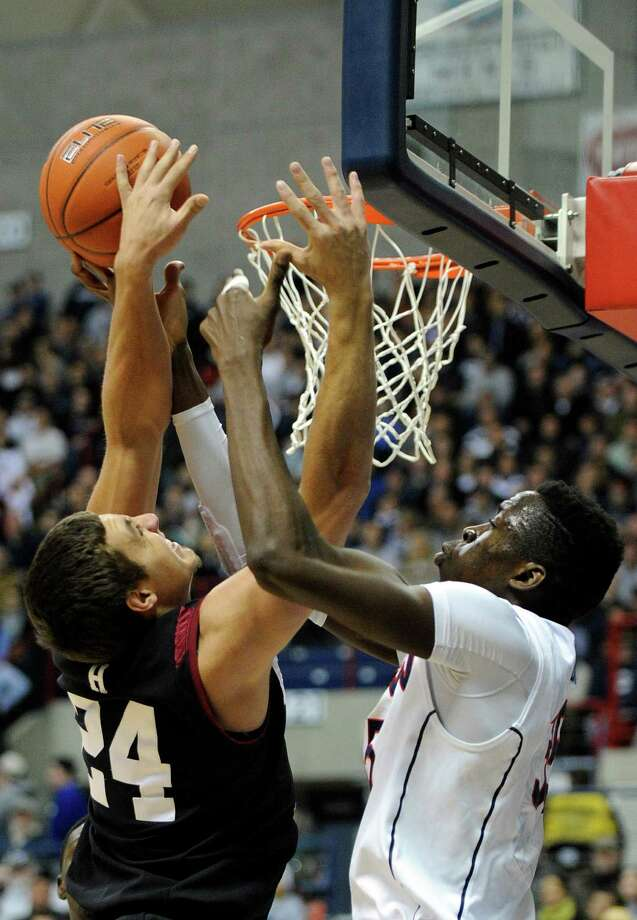 Harvard's Jonah Travis (24) fights for a rebound with Connecticut's Lasan Kromah (20) during the first half of an NCAA college basketball game in Storrs, Conn., Wednesday, Jan. 8, 2014. (AP Photo/Fred Beckham) Photo: Fred Beckham, Associated Press / Associated Press