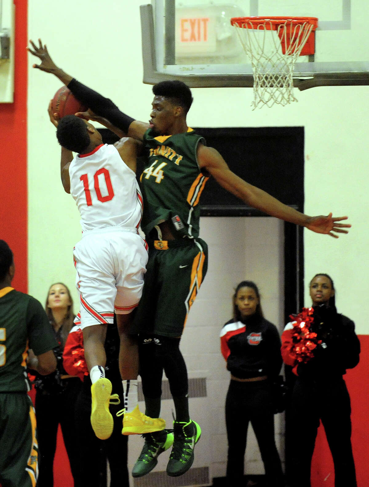 Trinity Catholic's Wyatt Garyk stops a shot attempt by Central's Sha'quan Bretoux, during boys basketball action in Bridgeport, Conn. on Wednesday January 8, 2014.