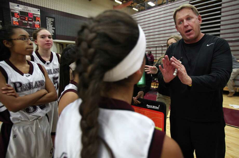 It's a far cry from guiding one of the state's most prominent high school football programs, but Pearland's Tony Heath is still showing his competitive fire as the fill-in coach of the school's freshman girls basketball team. Photo: Mayra Beltran, Staff / © 2013 Houston Chronicle