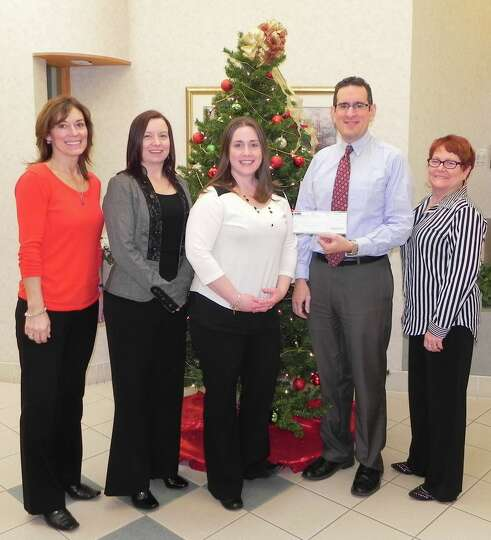 Community Resource Federal Credit Union?s employees presented Interfaith Partnership for the Homeles