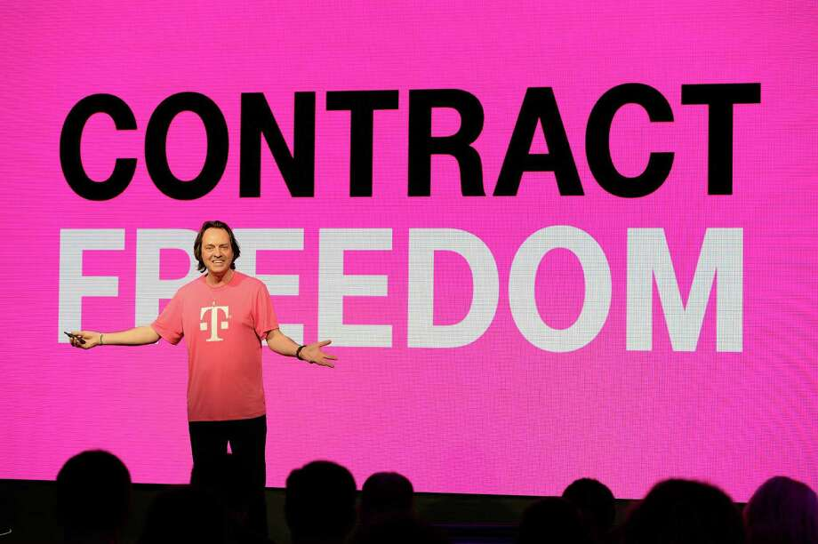 T-Mobile's chief executive, John Legere, is leading the No. 4-ranked wireless carrier in its effort against industry norms such as two-year contracts. Photo: Jeff Bottari, FRE / AP Images