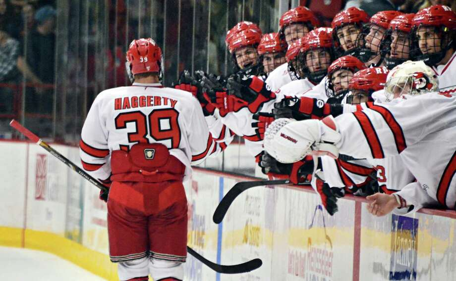 RPI's # 39 Ryan Haggerty, left, is congratulated by teammates after scoring a goal against Sacred Heart during Saturday's game at the Houston Field House Oct. 19, 2013, in Troy, NY.  (John Carl D'Annibale / Times Union) Photo: John Carl D'Annibale / 00024272A
