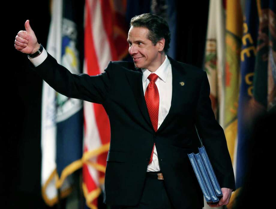 New York Gov. Andrew Cuomo arrives to deliver his annual State of the State address at the Empire State Plaza Convention Center on Wednesday, Jan. 8, 2014, in Albany, N.Y. (AP Photo/Mike Groll) ORG XMIT: NYMG116 Photo: Mike Groll / AP
