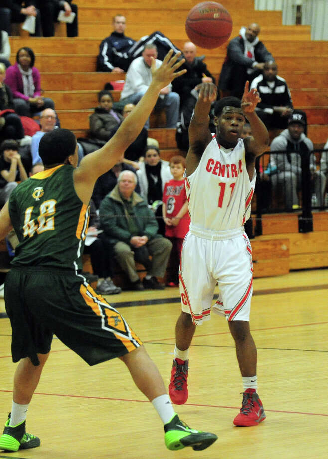 Boys basketball action between Trinity Catholic and Central in Bridgeport, Conn. on Wednesday January 8, 2014. Photo: Christian Abraham / Connecticut Post