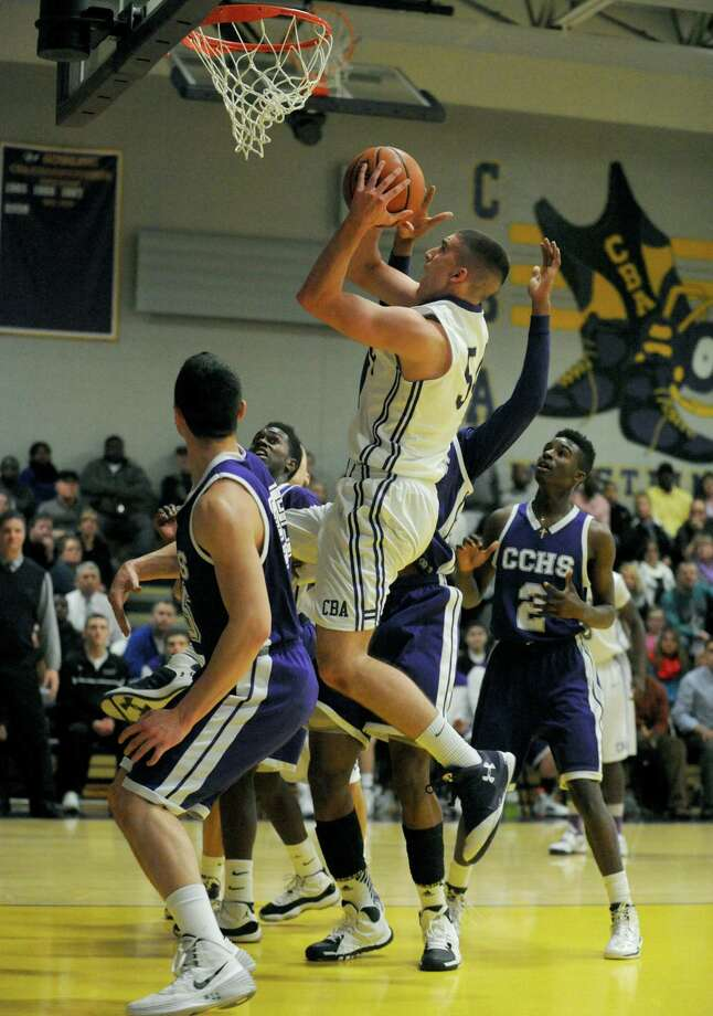 CBA's Greig Stire goes in for a score during their boys' high school basketball game against CCHS on Tuesday Jan. 7, 2014 in Colonie, N.Y. (Michael P. Farrell/Times Union) Photo: Michael P. Farrell / 00025262A