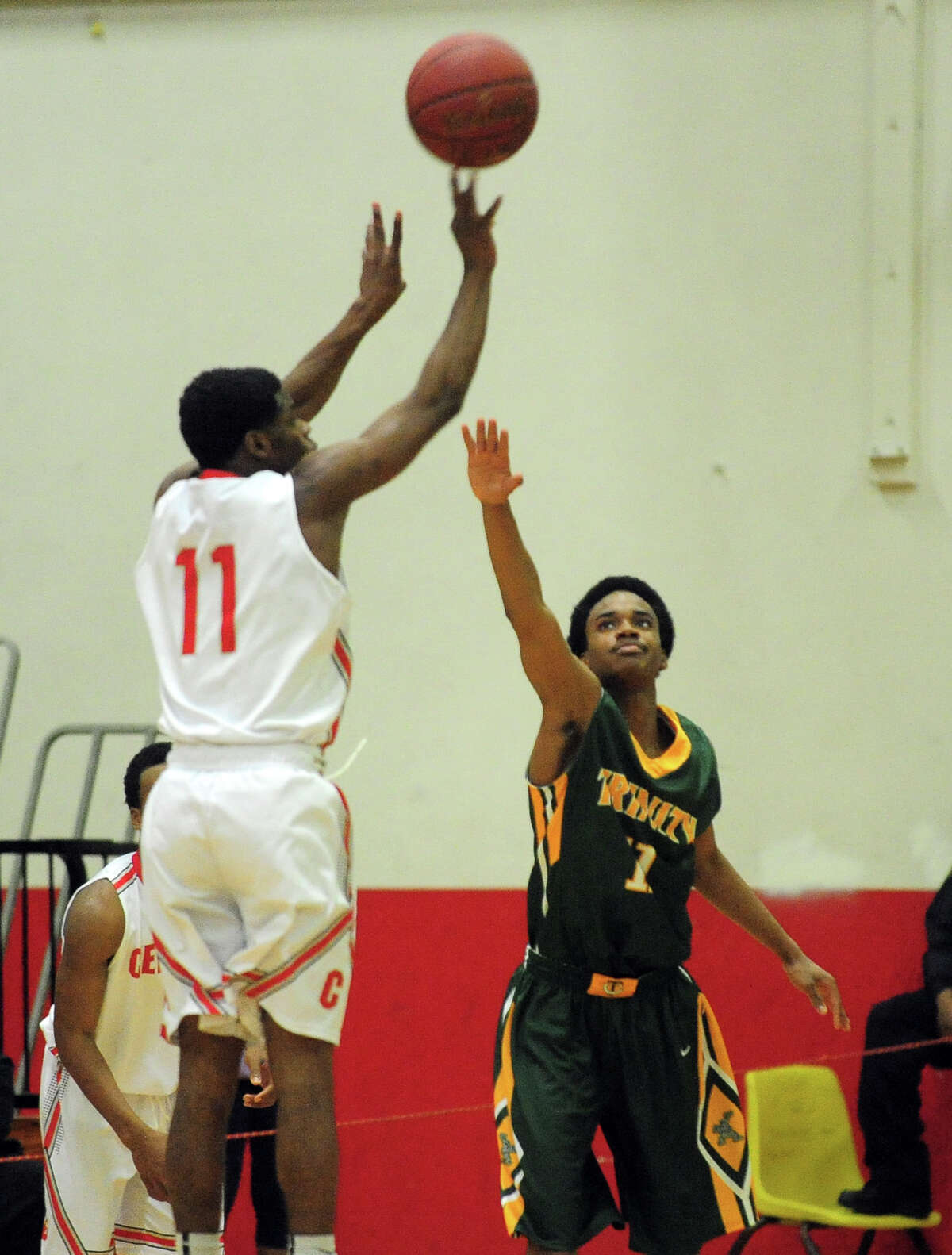 Boys basketball action between Trinity Catholic and Central in Bridgeport, Conn. on Wednesday January 8, 2014.