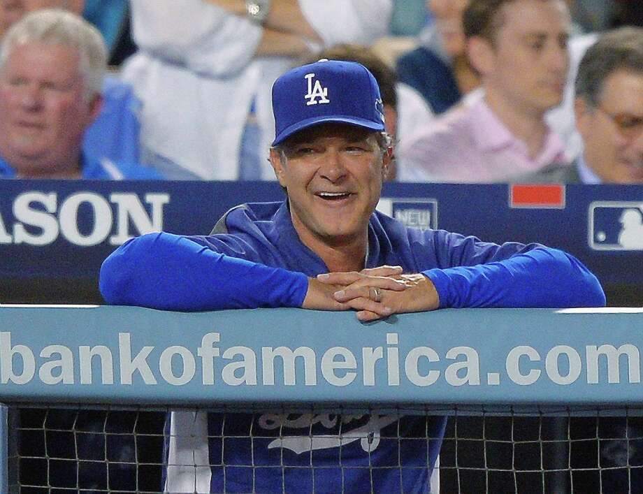 FILE - In this Oct. 14, 2013 file photo, Los Angeles Dodgers manager Don Mattingly smiles during a pitching change in the eighth inning of Game 3 of the National League baseball championship series against the St. Louis Cardinals, in Los Angeles. Mattingly will be back as manager of the Los Angeles Dodgers next season with a new three-year contract that takes him through 2016.  (AP Photo/Mark J. Terrill, File) ORG XMIT: NY168 Photo: Mark J. Terrill / AP