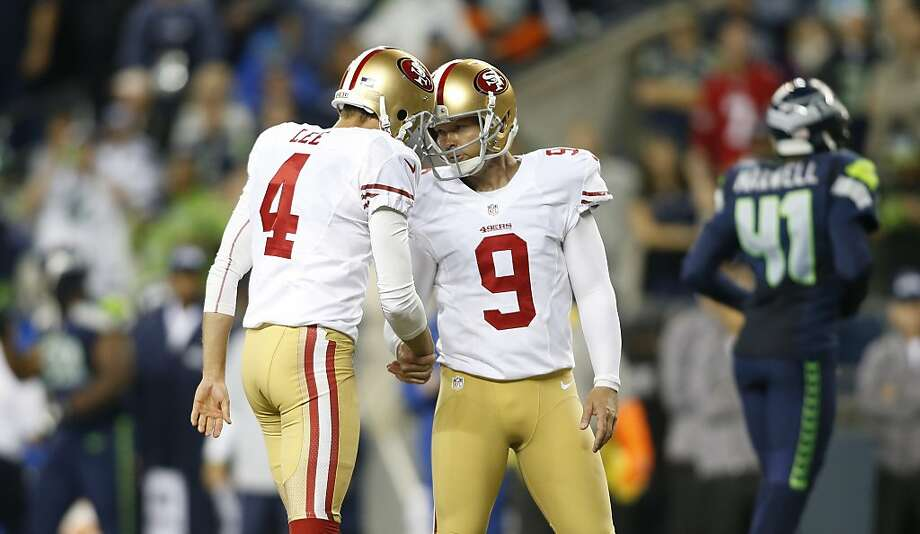 Phil Dawson (right) and Andy Lee collaborated on the 49ers' only points in the 29-3 loss to Seattle in September. Photo: John Froschauer, ASSOCIATED PRESS