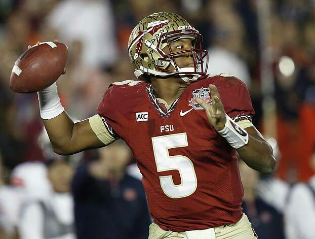 Florida State will be a clear favorite to start at No. 1 in the rankings with Heisman Trophy quarterback Jameis Winston, who led the Seminoles to the national title, back in the fold. Photo: Doug Benc / Associated Press / AP Images