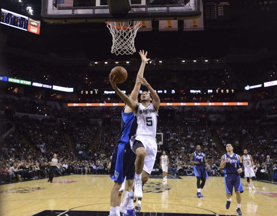 CoryJoseph of the San Antonio Spurs lays up the ball against the Dallas Mavericks during second-half NBA action at the AT&T Center on Wednesday, Jan. 8, 2014. Photo: Billy Calzada, San Antonio Express-News