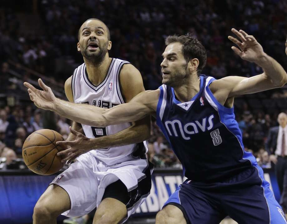 San Antonio Spurs' Tony Parker (9), of France, works against Dallas Mavericks' Jose Calderon (8), of Spain, during the first half on an NBA basketball game, Wednesday, Jan. 8, 2014, in San Antonio. Photo: Eric Gay, Associated Press