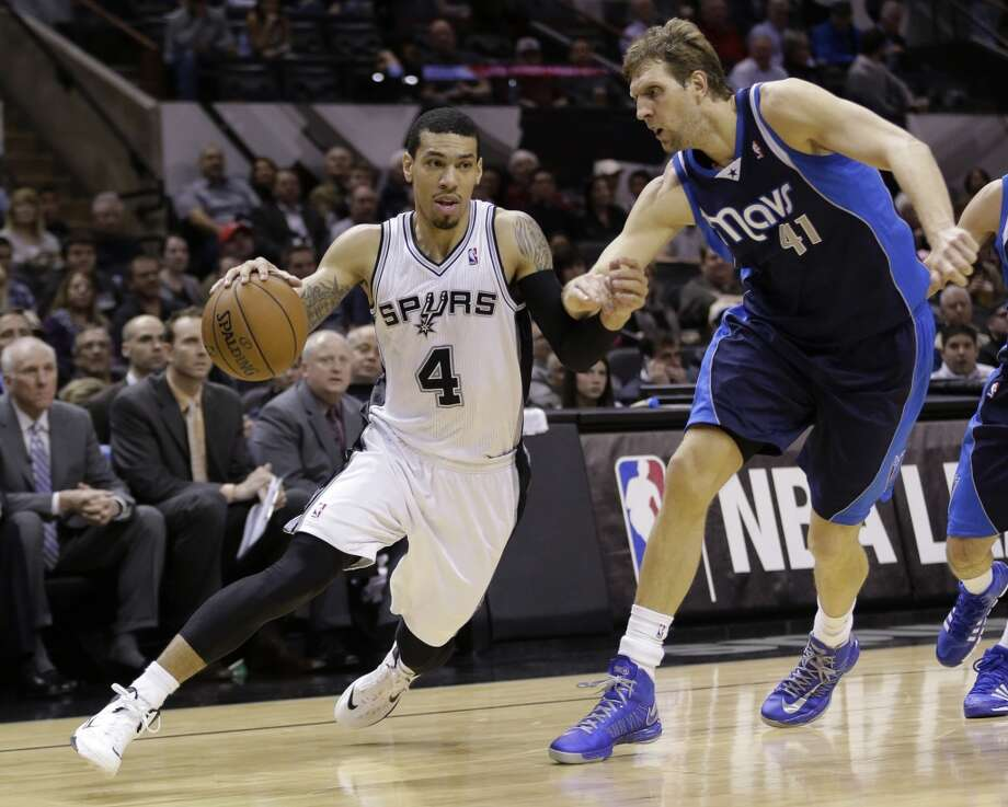 San Antonio Spurs' Danny Green (4) drives around Dallas Mavericks' Dirk Nowitzki (41), of Germany, during the first half on an NBA basketball game, Wednesday, Jan. 8, 2014, in San Antonio.  The Spurs won 112-90. Photo: Eric Gay, Associated Press