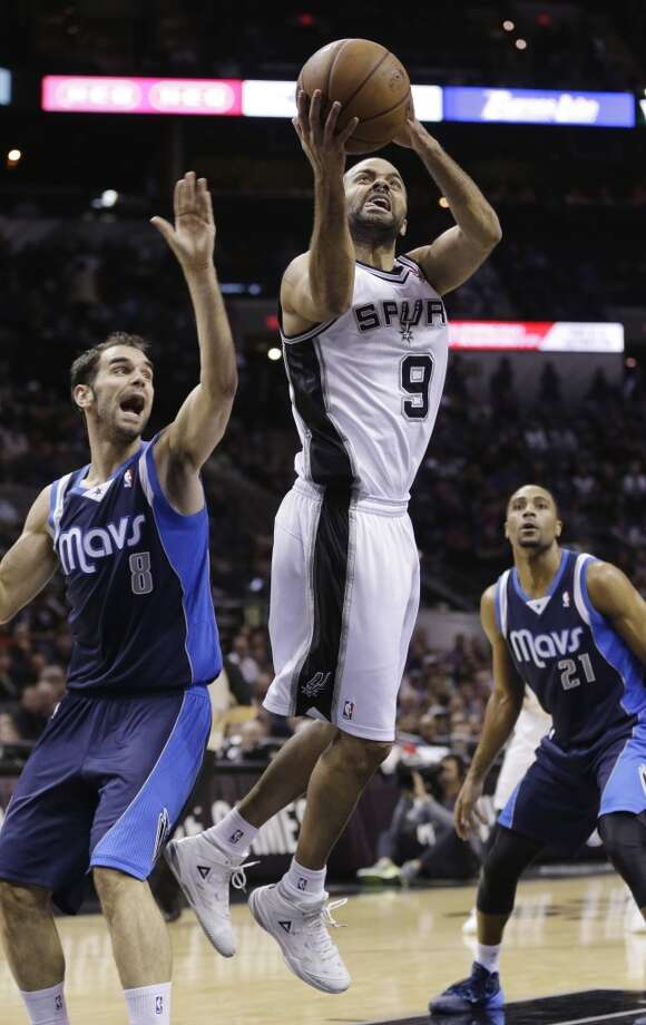 San Antonio Spurs' Tony Parker (9), of France, shoots next to Dallas Mavericks' Jose Calderon (8), of Spain, during the first half on an NBA basketball game, Wednesday, Jan. 8, 2014, in San Antonio. Photo: Eric Gay, Associated Press
