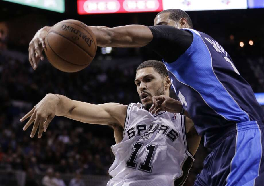 Dallas Mavericks' Brandan Wright (34) blocks a shot by San Antonio Spurs' Jeff Ayres (11) during the first half on an NBA basketball game, Wednesday, Jan. 8, 2014, in San Antonio. Photo: Eric Gay, Associated Press
