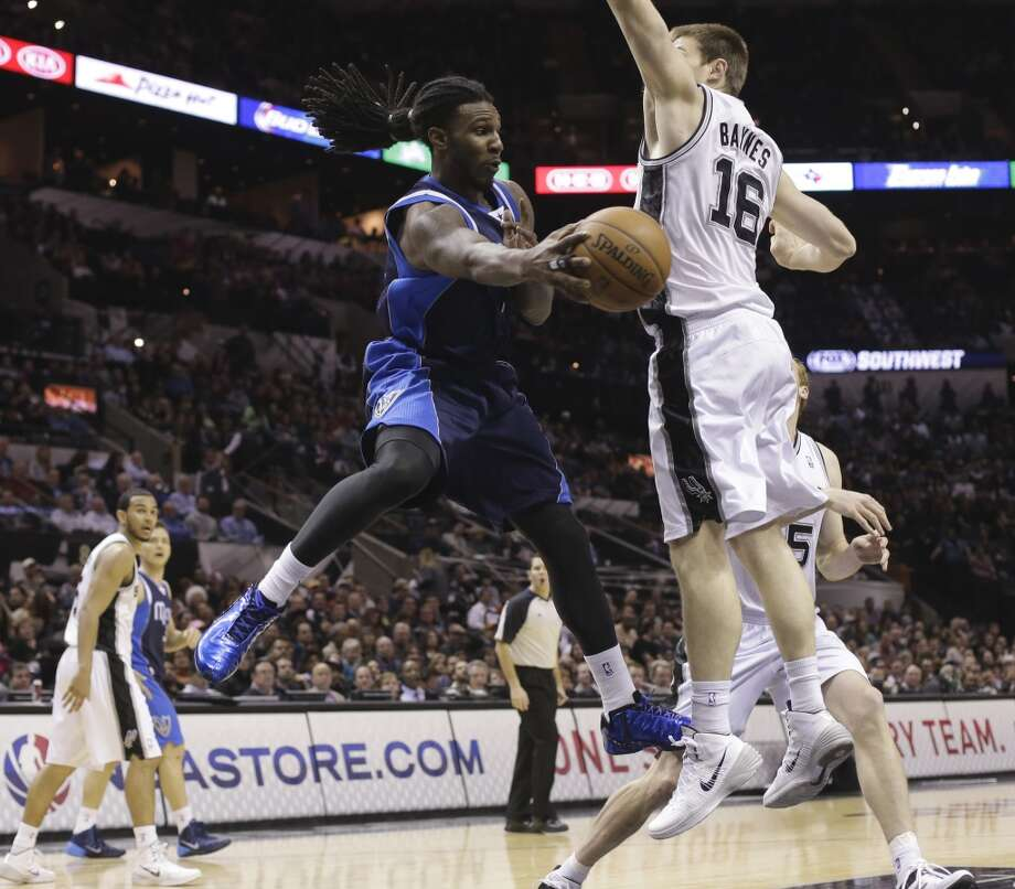 Dallas Mavericks' Jae Crowder passes around San Antonio Spurs' Aron Baynes (16), of Australia, during the second half on an NBA basketball game, Wednesday, Jan. 8, 2014, in San Antonio. San Antonio won 112-90. Photo: Eric Gay, Associated Press