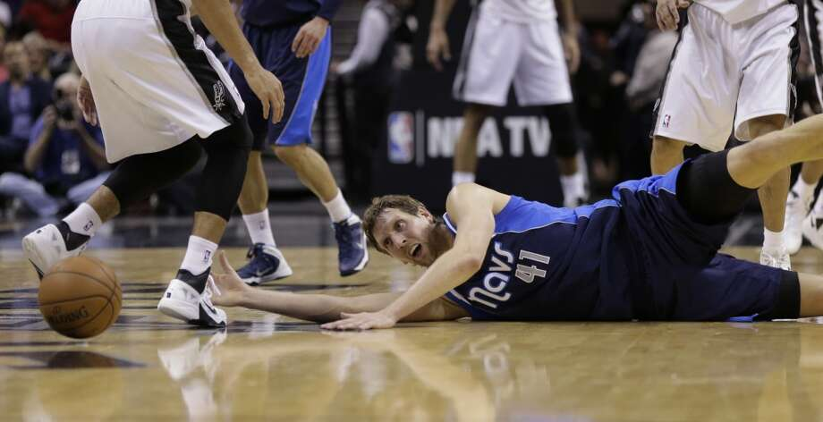 Dallas Mavericks' Dirk Nowitzki (41), of Germany,  dives for a loose ball during the first half on an NBA basketball game against the San Antonio Spurs, Wednesday, Jan. 8, 2014, in San Antonio. Photo: Eric Gay, Associated Press