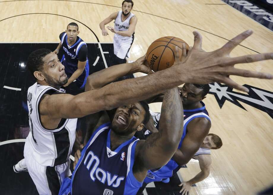 Dallas Mavericks' Jae Crowder (9) looks to the basket as San Antonio Spurs' Tim Duncan, left, defends during the first half on an NBA basketball game, Wednesday, Jan. 8, 2014, in San Antonio. Photo: Eric Gay, Associated Press