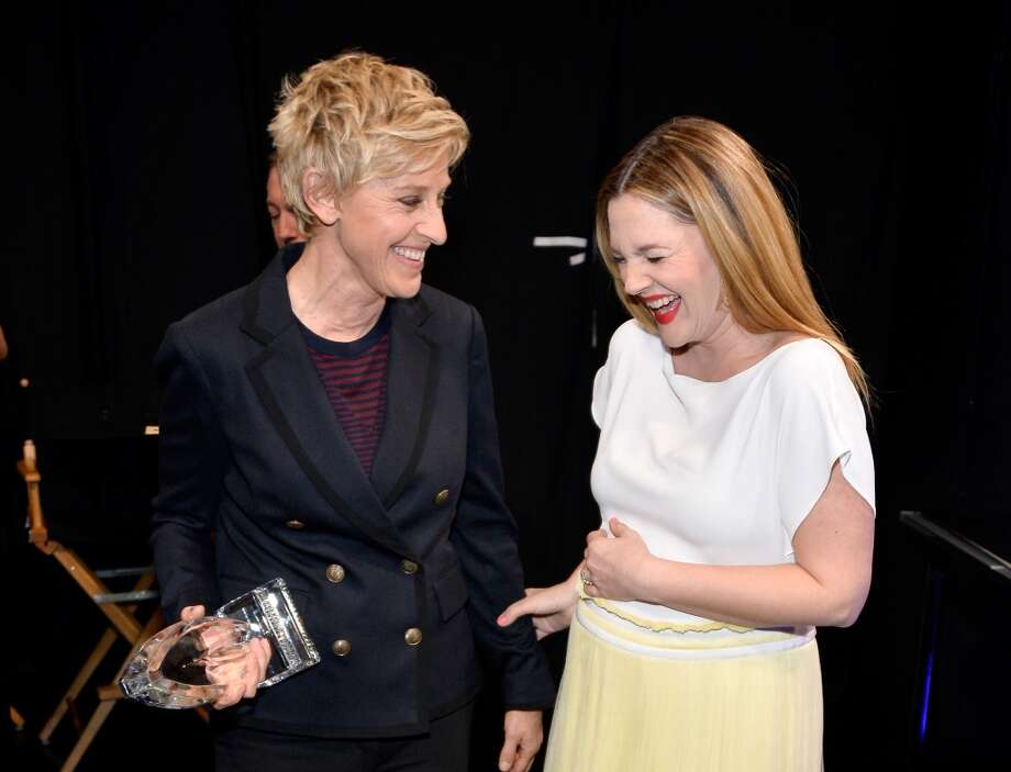 TV personality Ellen DeGeneres (L), winner of the Favorite Daytime TV Host award, and actress Drew Barrymore attend The 40th Annual People's Choice Awards at Nokia Theatre L.A. Live on January 8, 2014 in Los Angeles, California.  (Photo by Frazer Harrison/Getty Images for The People's Choice Awards) Photo: Frazer Harrison