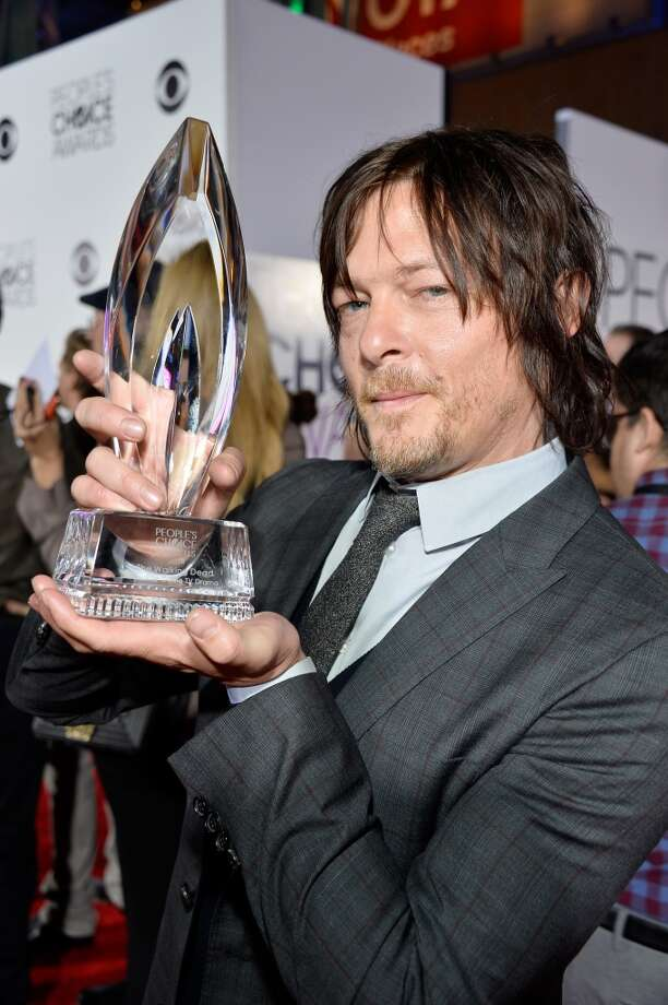 "Actor Norman Reedus poses with the Favorite Cable TV Drama award for ""The Walking Dead"" at The 40th Annual People's Choice Awards at Nokia Theatre L.A. Live on January 8, 2014 in Los Angeles, California.  (Photo by Frazer Harrison/Getty Images for The People's Choice Awards) Photo: Frazer Harrison"