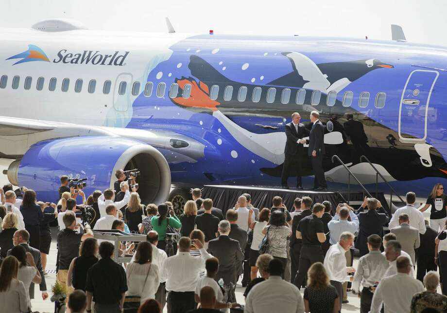 Southwest Airlines debuts a SeaWorld-themed plane in June. Despite a petition calling for the airline to end its partnership with SeaWorld, Southwest says the deal will continue. Photo: Southwest Airlines / Associated Press / Southwest Airlines