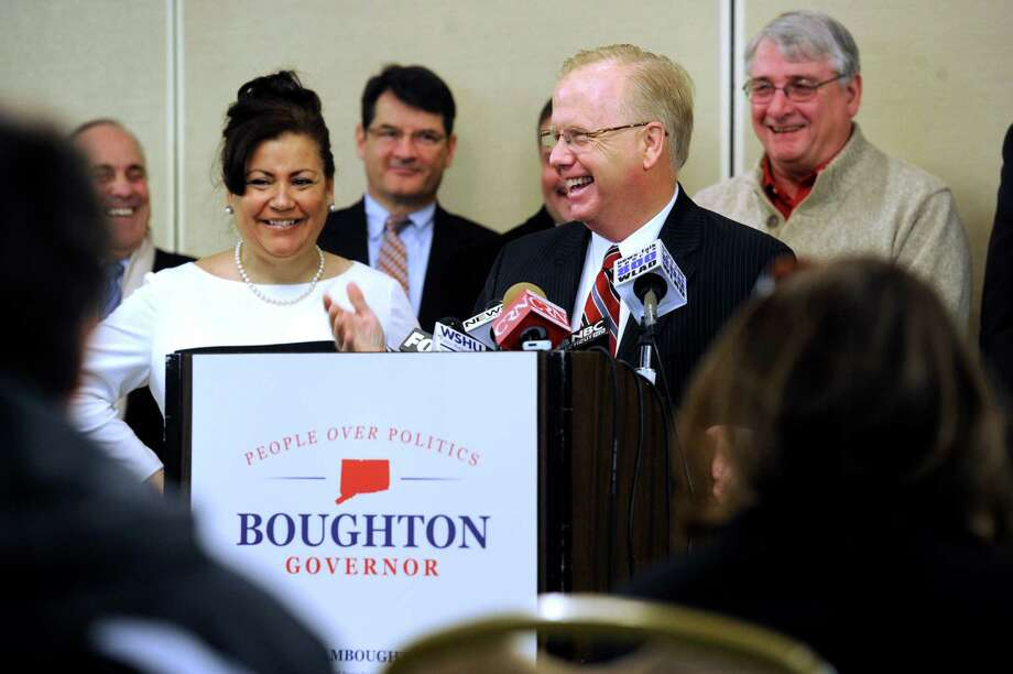 """Danbury Mayor Mark Boughton, right, with his wife Phyllis at his side, and Danbury City Council members behind him, announces his intention to run for governor during a news conference Wednesday, Jan. 8, 2014, in Danbury, Conn. The seven-term mayor said Wednesday he's seeking the Republican party's nomination this year because he believes Connecticut residents are not """"getting their fair share of the American dream."""" (AP Photo/The News-Times, Carol Kaliff) Photo: Carol Kaliff, Staff Photographer / Greenwich Time"""