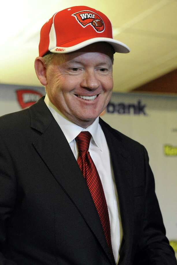 """New Western Kentucky head coach Bobby Petrino smiles during an NCAA college football news conference, Monday, Dec. 10, 2012, in Bowling Green, Ky. The 51-year-old was fired by Arkansas in April for a """"pattern of misleading"""" behavior following an accident in which the coach was injured while riding a motorcycle with his mistress as a passenger but now wants to make the most of his second chance. (AP Photo/The Daily News, Joe Imel) Photo: Joe Imel, MBO / The Daily News"""