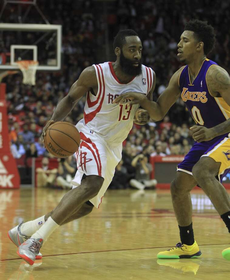 Rockets shooting guard James Harden (13) runs around Lakers small forward Nick Young (0). Photo: Karen Warren, Houston Chronicle